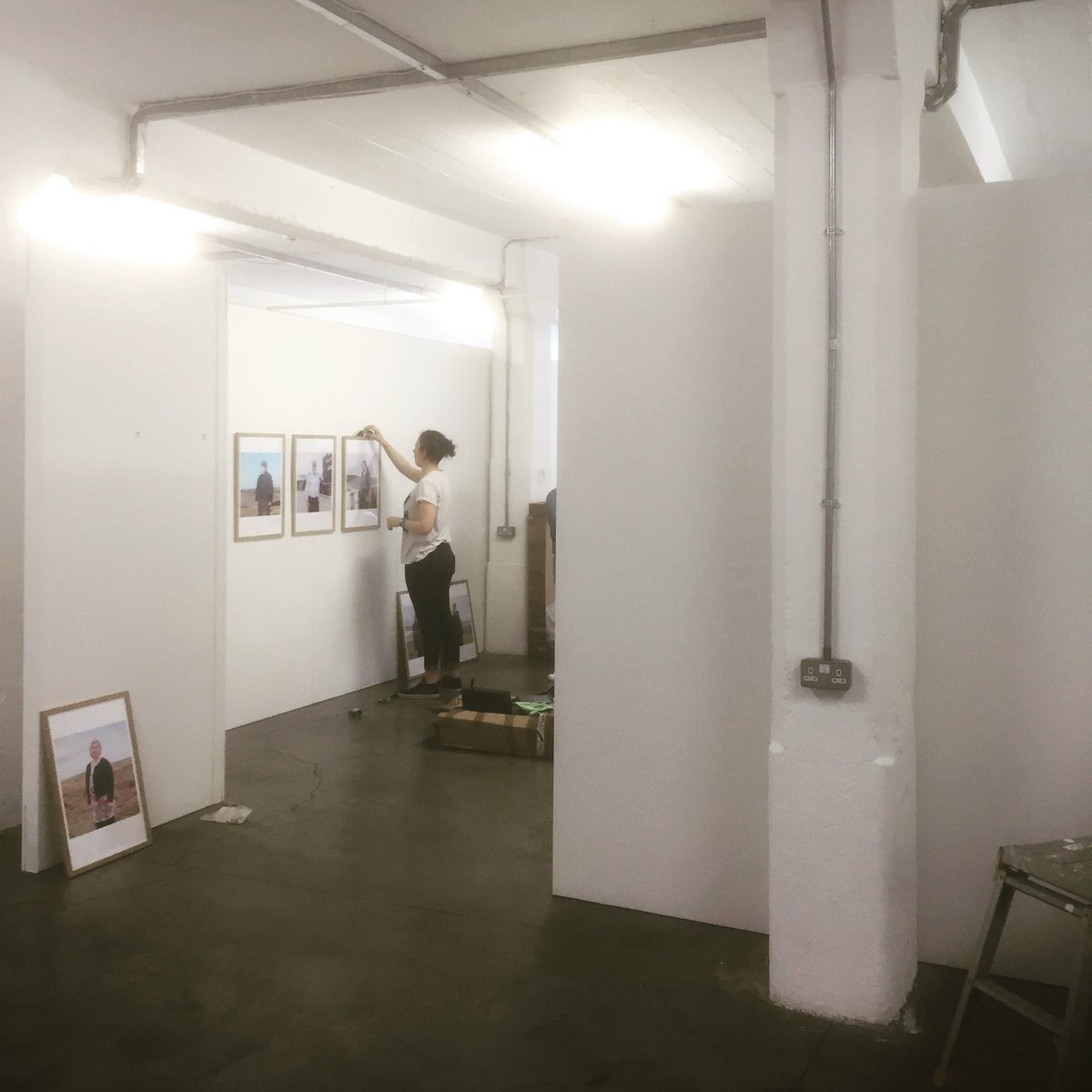 Installing exhibition walls for the Free Range Show at the Old Truman Brewery